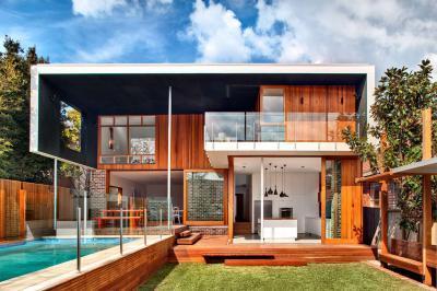 Hangulatos lakóház terasszal, medencével - homlokzat ötlet, modern stílusban