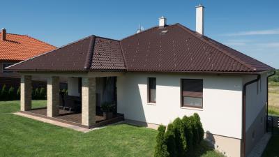 Modern ház barna színű betoncserepekkel - tető ötlet, modern stílusban